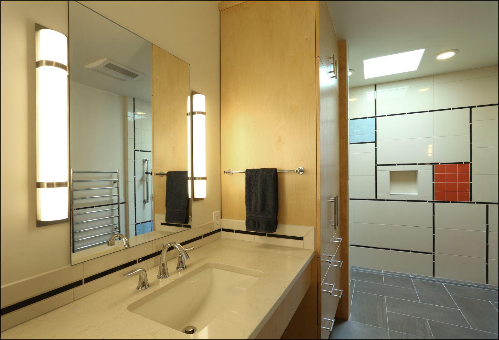 A black towel near the washbasin in the bathroom